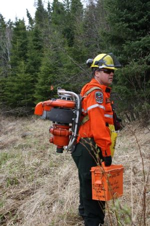 Crewmember with Pump and toolbox